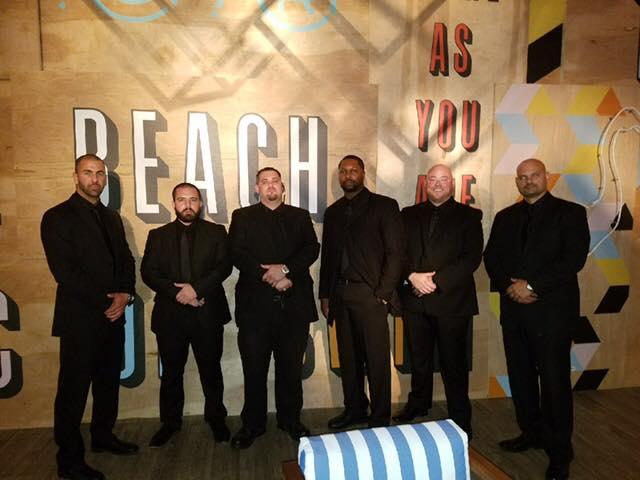 SFM Security Services Swim Week 2017 wiht 6 men dressing in black suits