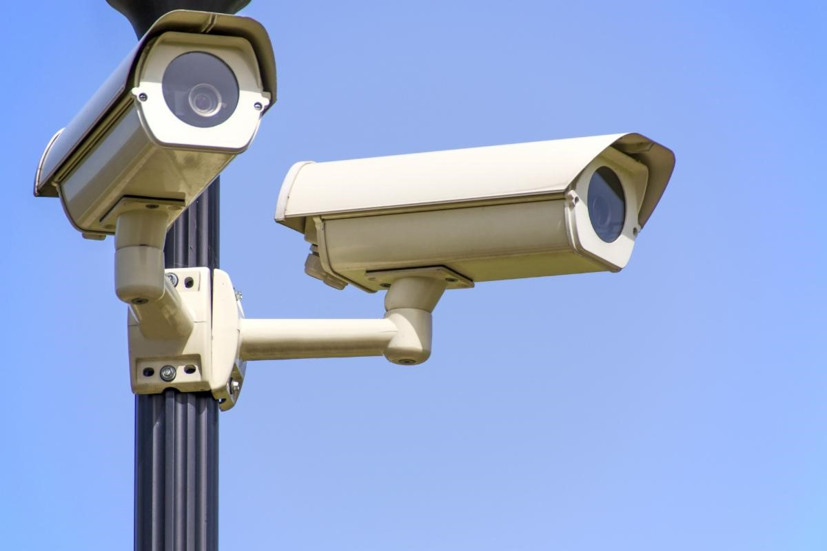 Security cameras stationed on a pole outside
