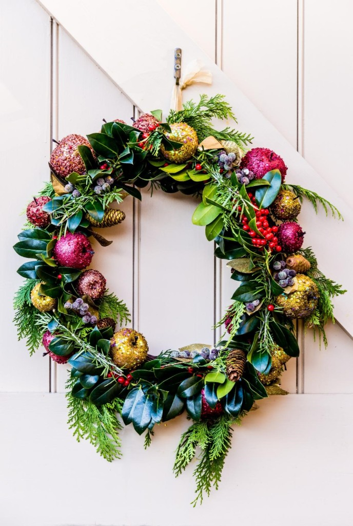 Colorful holiday wreath hanging on a door