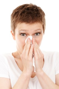Image of woman plowing her nose