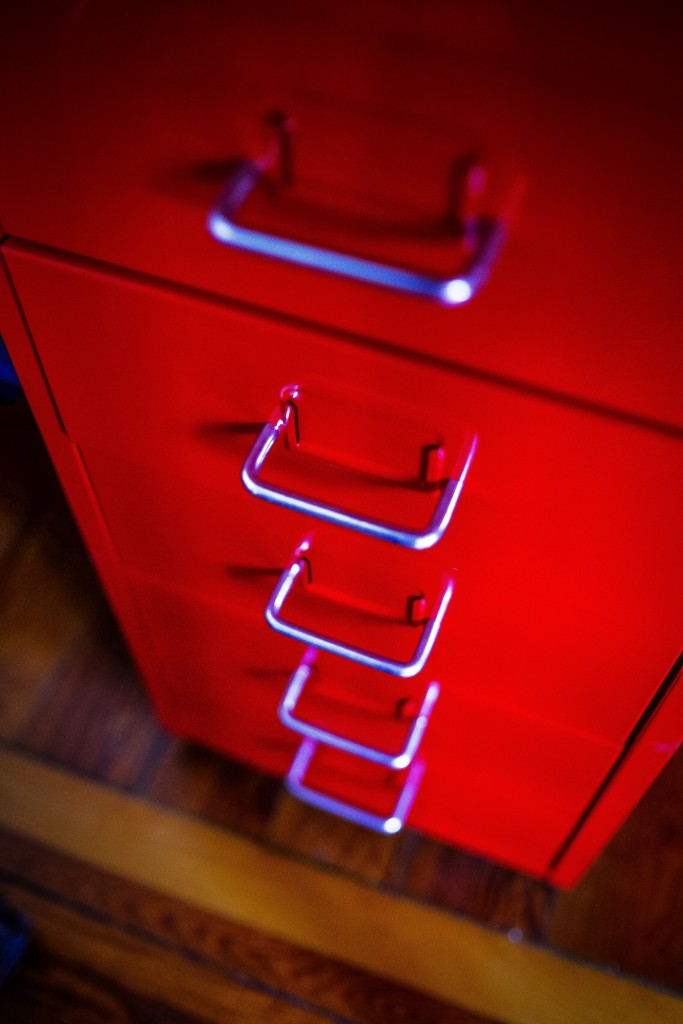 Close up of file cabinet with five handles