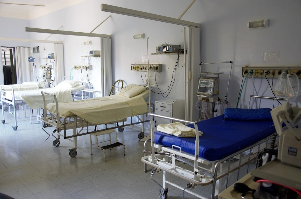 Hospital room with two beds is shown.